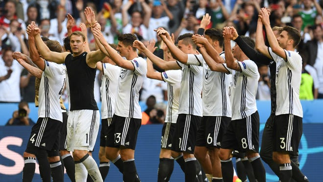 Germany's players celebrate at the end of the Euro 2016 Round of 16 football match between Germany and Slovakia