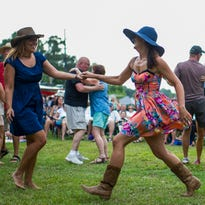 Jolene Price and Abby Perkins dance to music by Marcia Ball during the final Levitt AMP Lafayette Music Series concert at the Horse Farm in Lafayette, La., Wednesday, July 29, 2015.