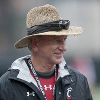 Bearcats head coach Tommy Tuberville smiles during practice in August.