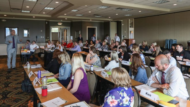Huff Realty agents and staff attend a training event on the Ninja selling system on Monday, May 21, 2018, at Devou Park in Covington, Kentucky.