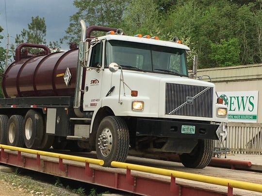 A tanker truck returns to the former Environmental Waste Solutions landfill to remove waste water, known as leachate from the facility on April 19.