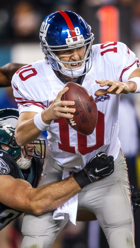 Giants quarterback Eli Manning is sacked by Eagles linebacker Connor Barwin in the fourth quarter of the Eagles 27-0 win over the Giants at Lincoln Financial Field on Sunday night, October 12, 2014.