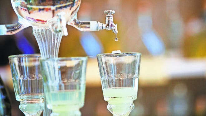 Absinthe is among the cocktails that can add adventure to your bar outings.
