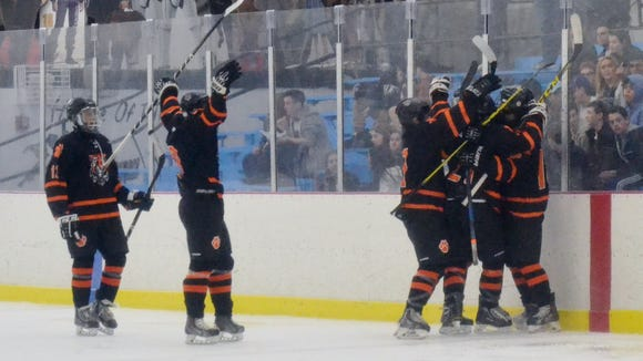 White Plains celebrates a second-period goal on Sunday at the Ice Hutch. The Tigers beat New Rochelle 6-5 to advance to a Section 1 Division I quarterfinal.