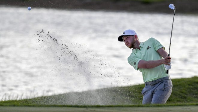 Daniel Berger hits out of the sand bunker on a 18th hole during the final round of the Honda Classic at PGA National in Palm Beach Gardens on Sunday.