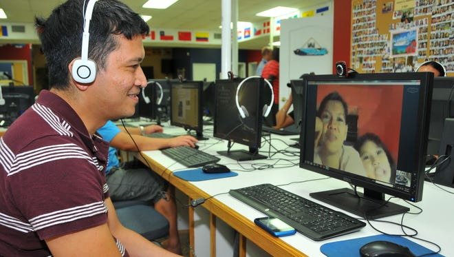 Gil Magtuloy, a steward on the Disney Dream, Skypes twice a week to his wife and 6-year-old daughter in the Philippines.