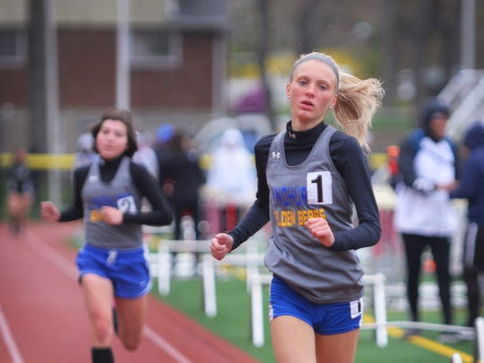 Giulia Pezzolla of Lyndhurst, finishes first and Kelly Weckstein of Lyndhurst fishes second in the 1600 meter in the Liberty heat during the NJIC Liberty and Patriot Track meet at Emerson High School in Emerson on 04/30/18.