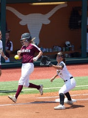Avery Kinney beats the throw to Liberty first baseman Harley Davis (7) for a single in the first inning Saturday.