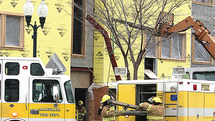 Construction worker trapped after concrete wall collapses