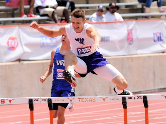 Cross Plains' Creed Goode clears a hurdle during the Class 1A boys 300-meter race at the UIL State Track and Field Championships at the University of Texas' Mike A. Myers Stadium in Austin on Saturday. Goode won silver with a time of 40.77 seconds.