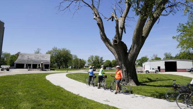 Cyclists make a stop in Minburn while riding the Raccoon River Valley Trail, which is one of longest paved loops in the U.S.