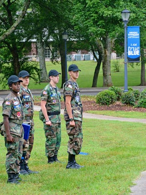 Senior cadet leaders of the Tennessee Wing Civil Air Patrol watch as members attending the weeklong Tennessee Wing Encampment, held on the MTSU campus, drill in front of the Cope Administration Building.