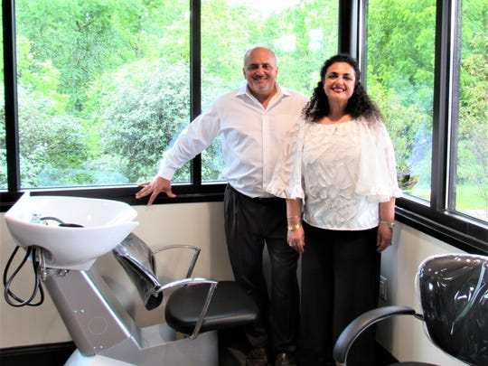 Owners Charlie and Suzanne Saah show off the state-of-the-art equipment in one of the available suites.