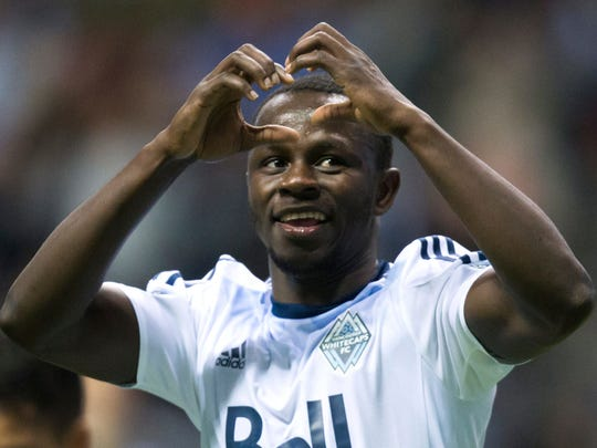 FILE - In this April 23, 2016, file photo, Vancouver Whitecaps' Kekuta Manneh celebrates his goal against FC Dallas during the second half of an MLS soccer game, in Vancouver, British Columbia. Seattle goalkeeper Stefan Frei and Vancouver midfielder Kekuta Manneh, both in the process of completing U.S. citizenship requirements, are among 32 players who will report to the first U.S. training camp since Bruce Arena replaced Jurgen Klinsmann as coach. (Darryl Dyck/The Canadian Press via AP, File)