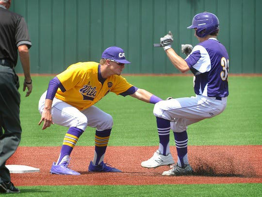 Brett Brown of the Godley Wildcats applies the tag at second base to Abilene Wylie's Sam King, (33) during the first game of Wednesday's double header playoff at Hoskins Field.