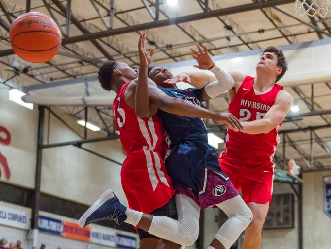 Cougars Jonathan Cisse is fouled as STM faces off against