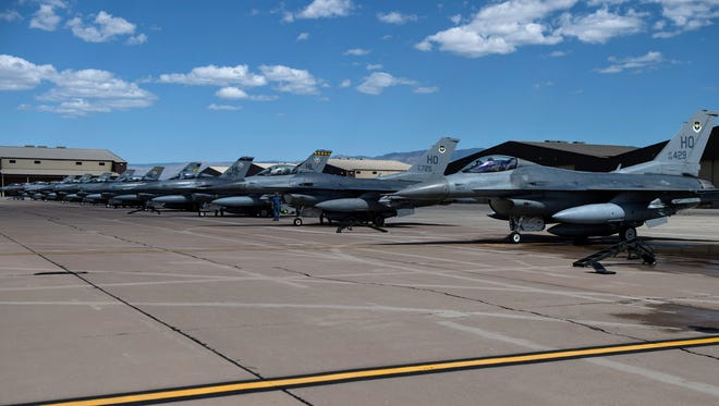 F-16 Fighting Falcons sit on the flight line at Holloman Air Force Base, Sept. 21. These F-16s were part of the final six-ship formation from Hill Air Force Base, Utah.