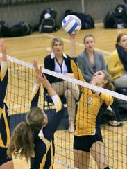 Sara Jensen tips a ball against South Lyon on Wednesday.