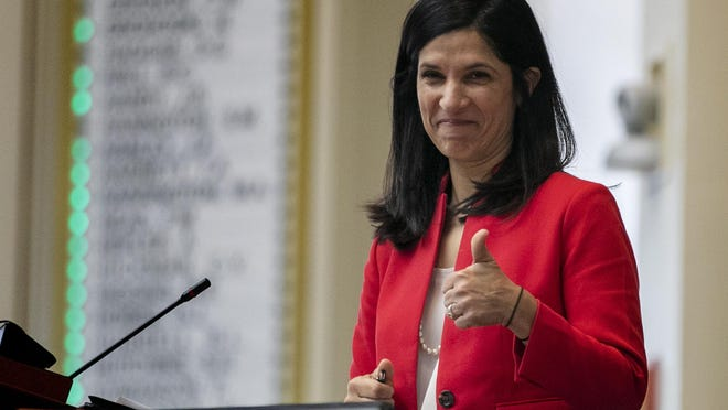 In this Jan. 8, 2020, file photo, House speaker Sara Gideon, D-Freeport, flashes a thumbs up at a Democratic colleague prior to the start of the first session of the new year at the State House in Augusta, Maine.