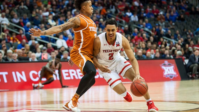 March 8: Texas guard Jacob Young, left, guards Texas Tech guard Zhaire Smith (2) as he dribbles in the first half of their game in the Big 12 tournament at Sprint Center in Kansas City.