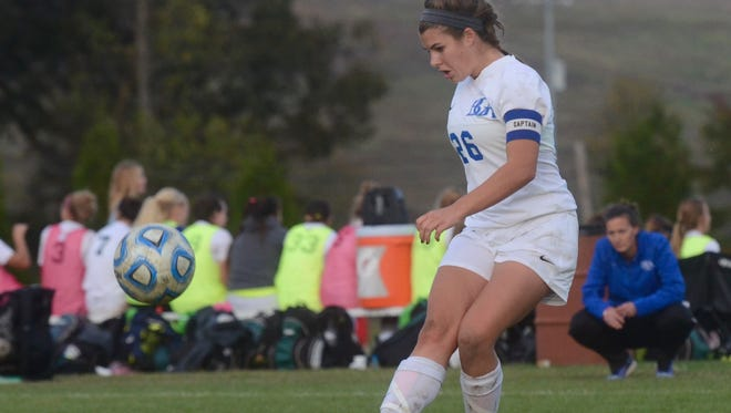 Battle Ground Academy junior midfielder Chloe Tremblay scores on a second-half free kick during Friday's Division II-A semifinal against St. George's.