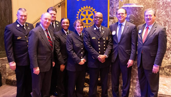From left; Fire Capt. Matthew Flagler, Rotary member Barry Evans of Anderson Township, who chaired the recognition program; Fire Capt. John Raterman, Firefighter Alexis Rodgers, Firefighter Camela Turrin, Asst. Fire Chief Anson Turley, Rotary Club President Rick Flynn of Evendale and Rotarian Bill Stille of Mount Carmel, who sponsored the meeting.
