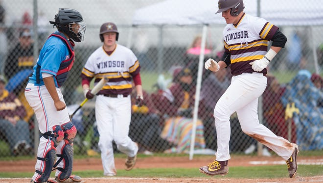 Zach Watts of Windsor crosses home plate during a game against Weld Central High School Saturday. The Wizards defeated the Rebels 16-0 and then beat Pueblo Centennial 3-0 to advance to the state tournament.