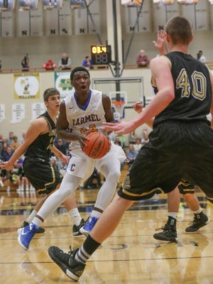 Carmel's Ethan Merriweather drives to the hoop against Noblesville, March 2, 2015. 2016 in sectional action.