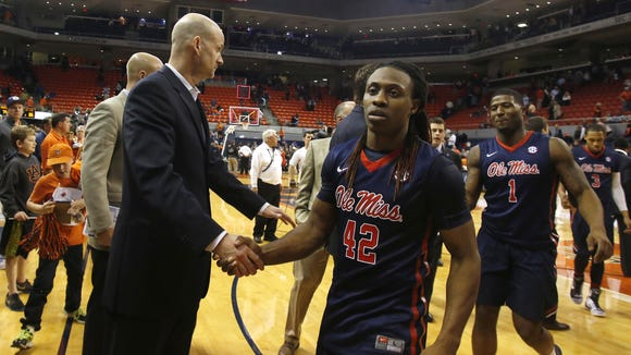 Mississippi coach Andy Kennedy and Stefan Moody shake hands heading off the court after beating Auburn 86-79 in their NCAA college basketball game on Saturday, Feb. 7, 2015, in Auburn, Ala. (AP Photo/Opelika-Auburn News, Todd J. Van Emst)