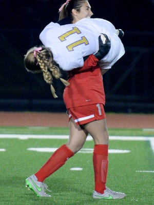 Maddy Talbot carries Maggie Weldon to celebrate a goal in Byrd's 3-0 win over Parkway earlier this season