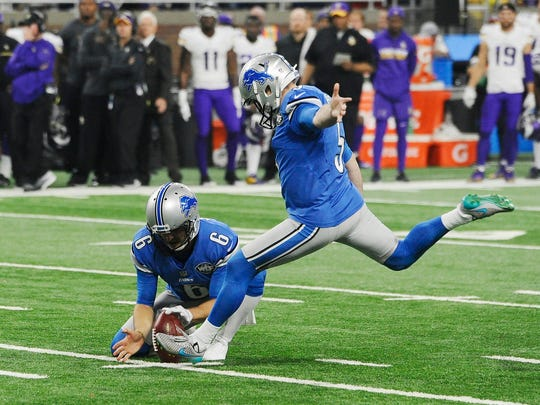 Lions kicker Matt Prater sends the game winning field goal, held by punter Sam Martin, to beat the Vikings 16-13 at the end of the fourth quarter.
