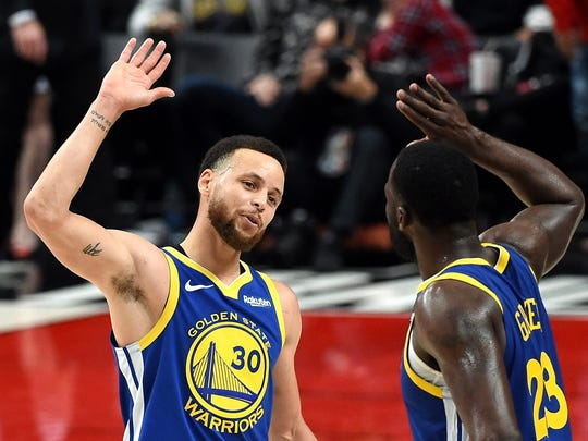 Stephen Curry (left) celebrates with Draymond Green during the second half against the Portland Trail Blazers in Game 3 of the NBA Western Conference Finals at Moda Center on May 18, 2019.