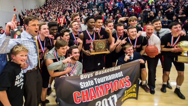 Rutland players celebrate after winning the Vermont state boys high school championship at Patrick Gymnasium in Burlington on Monday night, March 13, 2017. Rutland won for the first time in 50 years, 43-37, over CVU after a tie forced the game into overtime.