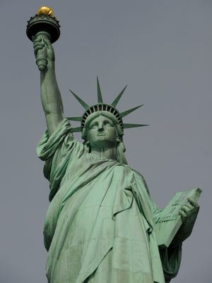 Maybe we've got the wrong inscription on the Statue of Liberty.
