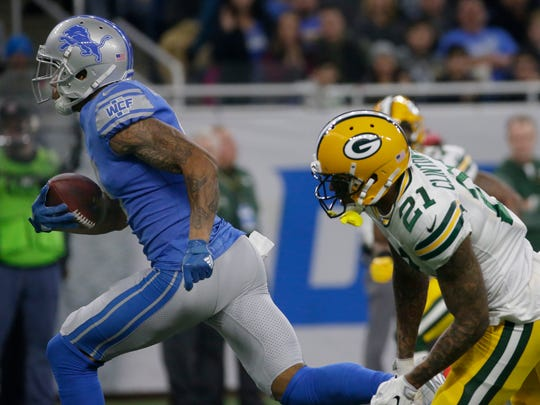 Detroit Lions wide receiver Kenny Golladay (19) blows through an attempted tackle by Green Bay Packers free safety Ha Ha Clinton-Dix (21) to score a 54-yard touchdown during the second quarter on Dec. 31, 2017, at Ford Field in Detroit.