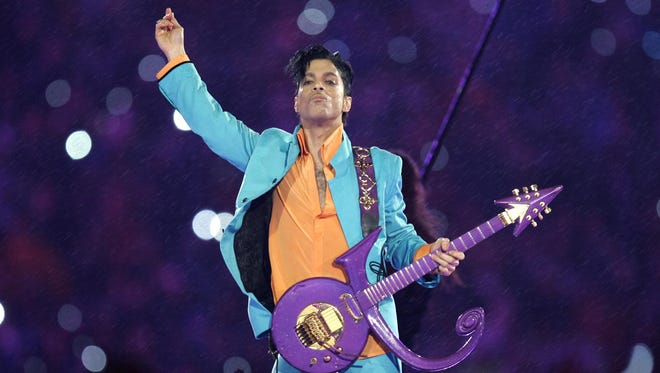 Prince performs in 2007 during the halftime show at the Super Bowl XLI football game at Dolphin Stadium in Miami.