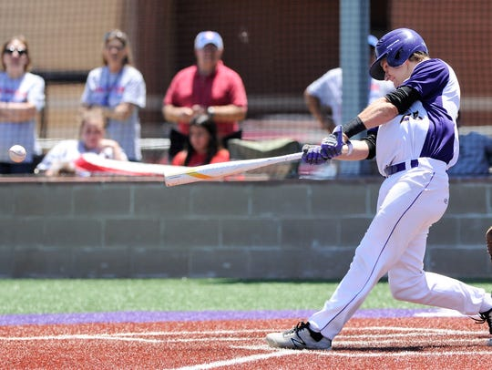 Wylie catcher Caleb Munton (25) turns on a pitch for