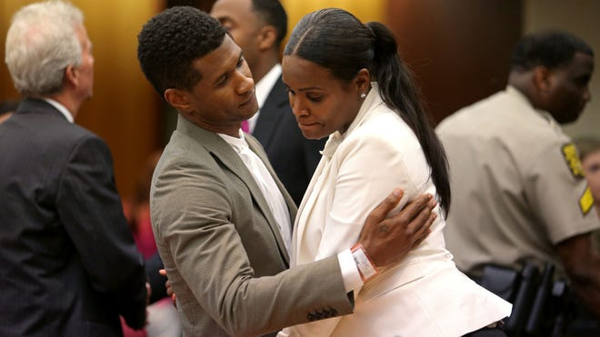 After getting partial custody of two of their sons, Usher talks with his ex-wife, Tameka Foster Raymond, in Atlanta.