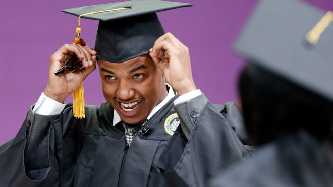 Krishaun Branch dresses for his graduation ceremony from Fisk University in Nashville on May 5, 2014.