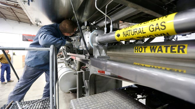 On Jan. 17, 2013, technician Sean Cline works on a diesel engine used in fracking at a facility in Gibsonia, Pa.