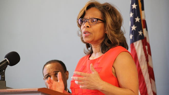 Attorney General Karol Mason, director of the Office of Justice Programs, speaks at a press conference Dec. 3, 2013. Mason said her office would help state and local law enforcement agencies overhaul their investigative procedures to prevent wrongful convictions