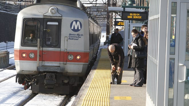 Commuters wait for a New Haven line train in Port Chester in this Journal News file photo.