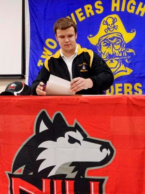 Jordan Steckler signs his National Letter of Intent to play football at Northern Illinois University in a classroom at Two Rivers High School on Wednesday.