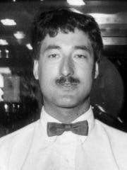 Tim Burnett, 28, had come in to his job at the Drake Diner to help set up a Christmas tree before he was killed in the 1992 shooting.
