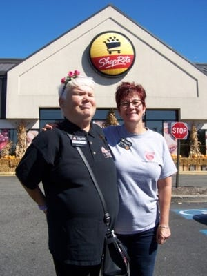 Sharon Mohry (left), a person with disabilities, with Laura Augustine, ShopRite From Home manager, in front of the Clark ShopRite.
