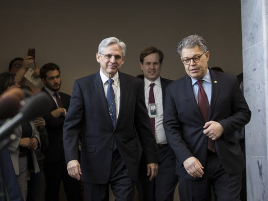 Merrick Garland walks with Sen. Al Franken, D-Minn.,