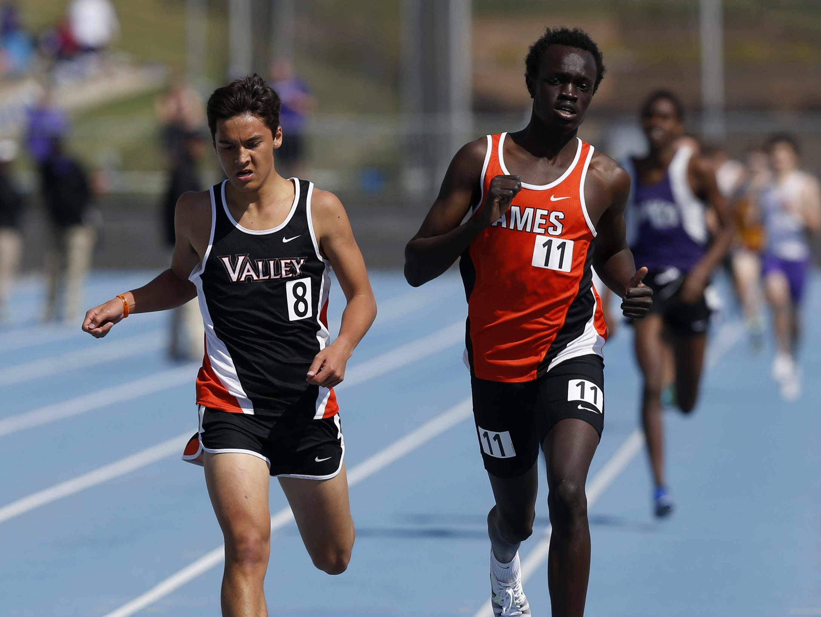 West Des Moines Valley's Daniel Soto (left) gets edged out at the finish line by Ames' Atem Akok in the Duncan Invitational 1,600 Saturday.