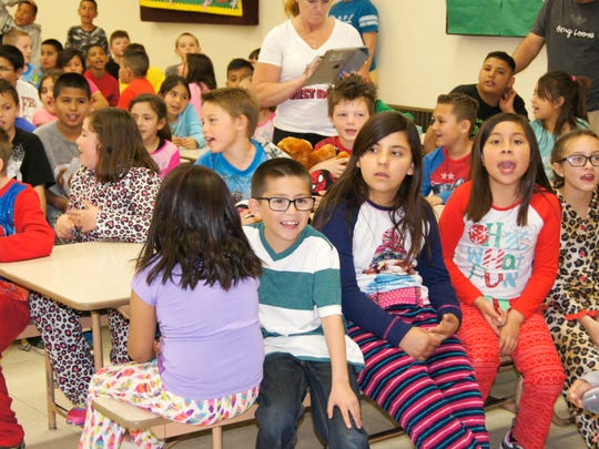 "Sixth Street Elementary students sing ""Happy Birthday"" to author Dr. Seuss on Wednesday."