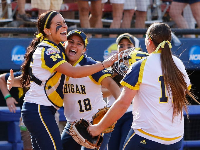 Michigan catcher Lauren Sweet, left, third baseman