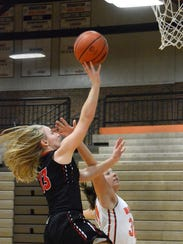 Pinckney's Allison Thelen takes a shot while being